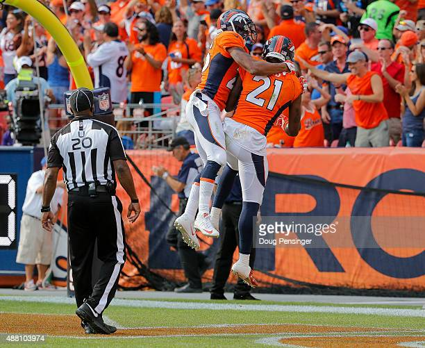 Cornerback Aqib Talib of the Denver Broncos celebrates with cornerback Chris Harris after returning an interception for a touchdown in the third...