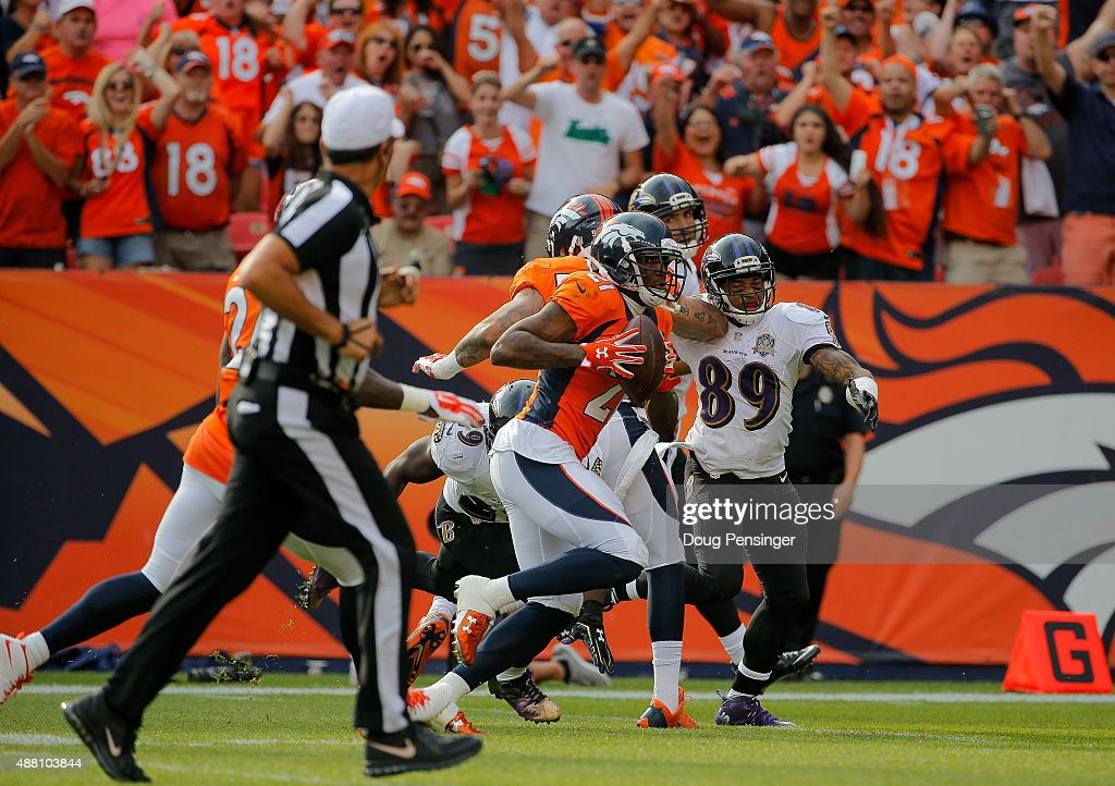 Cornerback Aqib Talib #21 of the Denver Broncos returns an interception of quarterback Joe Flacco #5 of the Baltimore Ravens (not pictured) for a touchdown in the third quarter of a game at Sports Authority Field at Mile High on September 13, 2015 in Denver, Colorado.