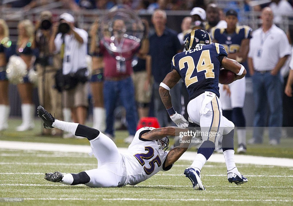 Cornerback Asa Jackson #25 of the Baltimore Ravens attempts to make a diving tackle on running back <a gi-track='captionPersonalityLinkClicked' href=/galleries/search?phrase=Isaiah+Pead&family=editorial&specificpeople=6237657 ng-click='$event.stopPropagation()'>Isaiah Pead</a> #24 of the St. Louis Rams during the game against the St. Louis Rams at the Edward Jones Dome on August 30, 2012 in St. Louis, Missouri. The St. Louis Rams defeated the Baltimore Ravens 31-17.