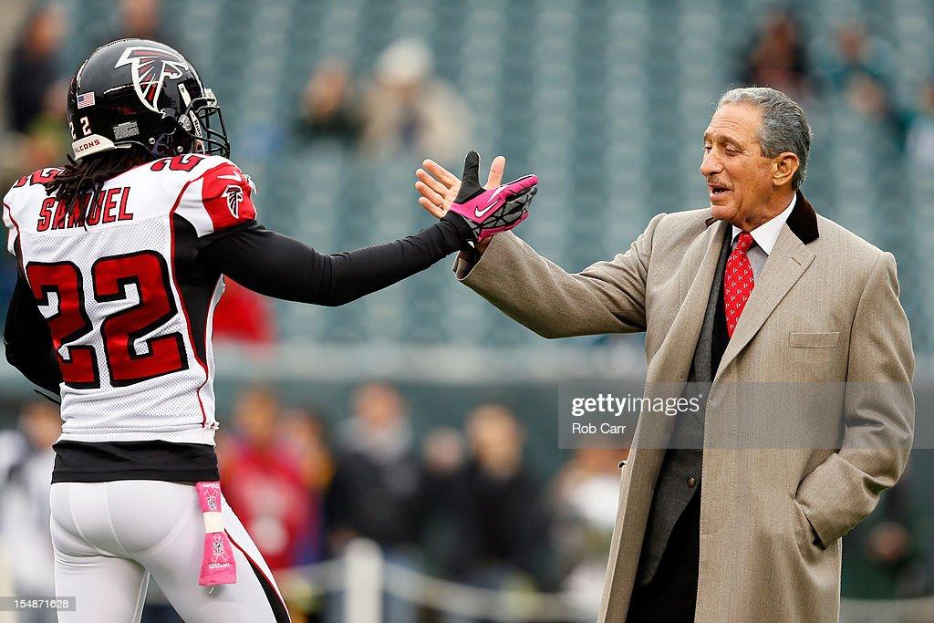 Cornerback Asante Samuel of the Atlanta Falcons high fives Falcons owner Arthur Blank before the start of the Falcons game against the Philadelphia...