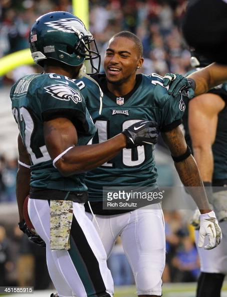 Cornerback Brandon Boykin of the Philadelphia Eagles is congratulated by teammate wide receiver DeSean Jackson after intercepting a pass in the end...