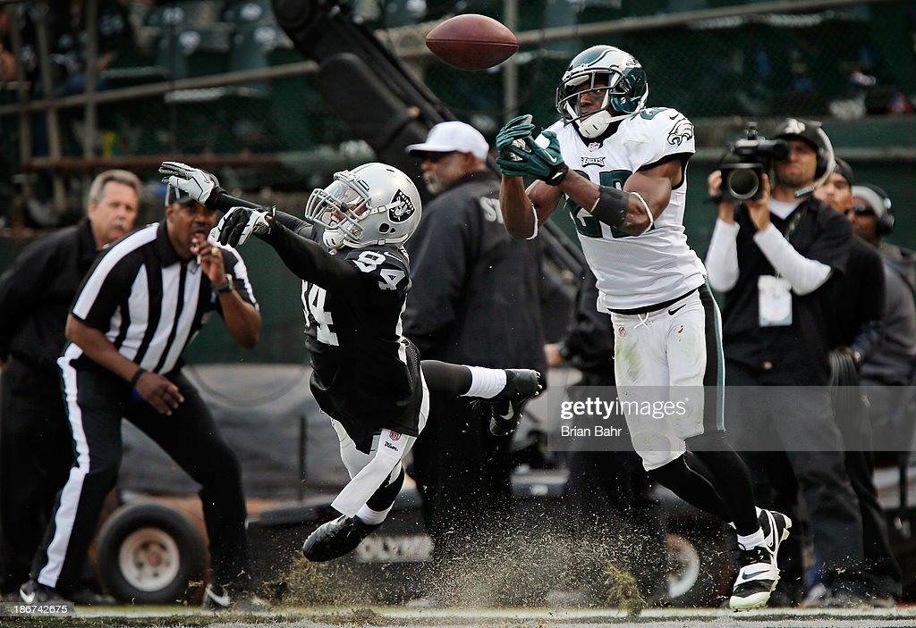 Cornerback <a gi-track='captionPersonalityLinkClicked' href=/galleries/search?phrase=Brandon+Boykin&family=editorial&specificpeople=5610340 ng-click='$event.stopPropagation()'>Brandon Boykin</a> #22 of the Philadelphia Eagles nearly intercepts a pass intended for wide receiver <a gi-track='captionPersonalityLinkClicked' href=/galleries/search?phrase=Juron+Criner&family=editorial&specificpeople=6535045 ng-click='$event.stopPropagation()'>Juron Criner</a> #84 of the Oakland Raiders in the endzone in the fourth quarter on November 3, 2013 at O.co Coliseum in Oakland, California. The Eagles won 49-20.