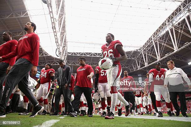 Cornerback Brandon Williams of the Arizona Cardinals runs off the field prior to the start of the NFL game against the Tampa Bay Buccaneers at the...