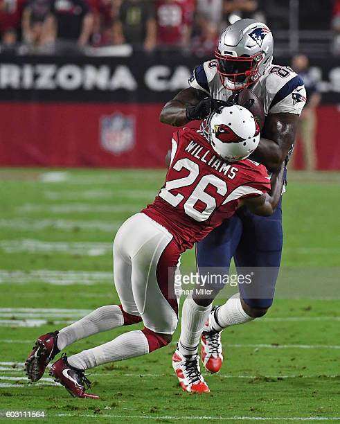 Cornerback Brandon Williams of the Arizona Cardinals tackles tight end Martellus Bennett of the New England Patriots after a reception during the NFL...