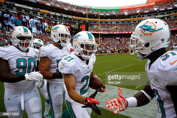 Cornerback Brent Grimes of the Miami Dolphins celebrates in the first half during a game against the Washington Redskins at FedExField on September...