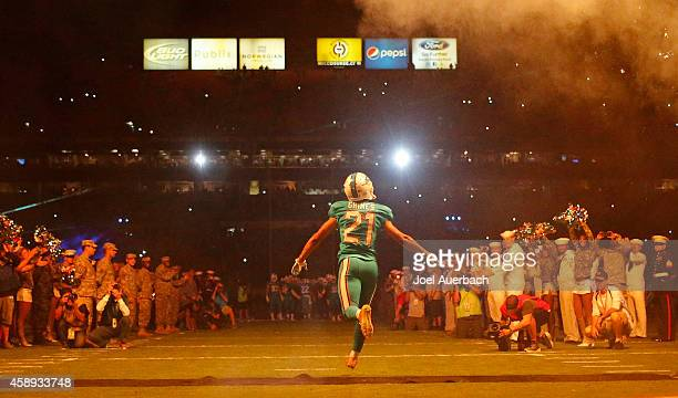Cornerback Brent Grimes of the Miami Dolphins runs onto the field before his team met the Buffalo Bills in a game at Sun Life Stadium on November 13...