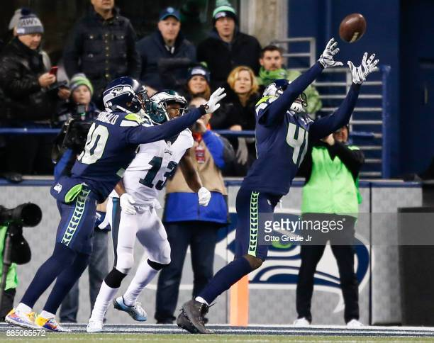 Cornerback Byron Maxwell of the Seattle Seahawks makes an interception on a pass intended for wide receiver Nelson Agholor of the Philadelphia Eagles...