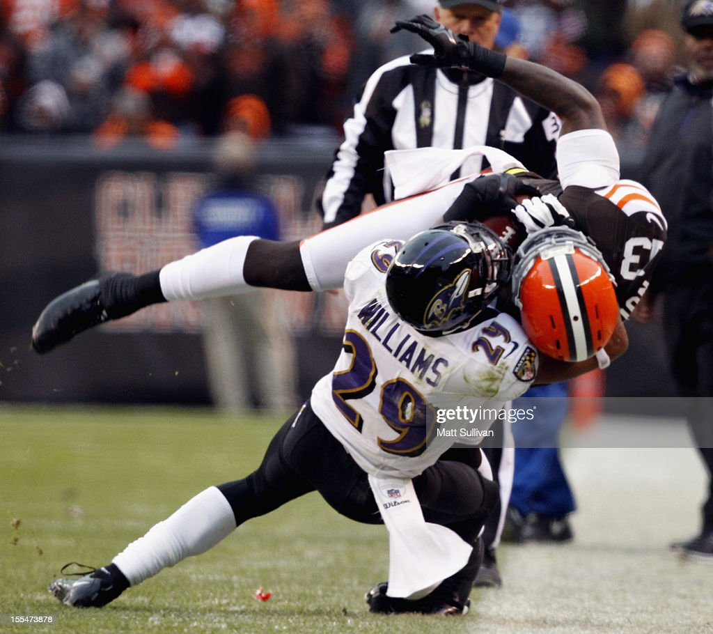 Cornerback Cary Williams #29 of the Baltimore Ravens tackles wide receiver Josh Gordon #13 at Cleveland Browns Stadium on November 4, 2012 in Cleveland, Ohio.