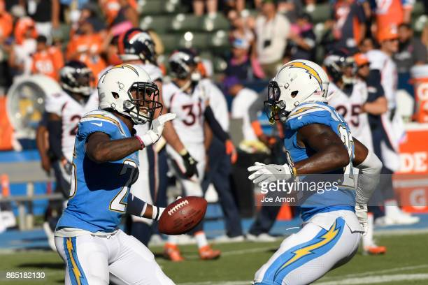 Cornerback Casey Hayward and defensive back Desmond King of the Los Angeles Chargers celebrates his interception in the second half as the Denver...