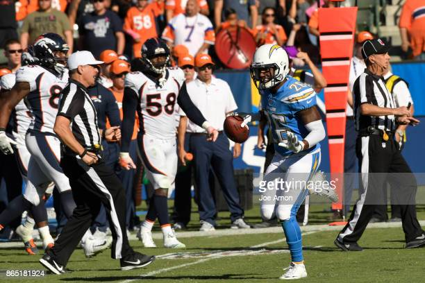Cornerback Casey Hayward of the Los Angeles Chargers celebrates his interception in the second half as the Denver Broncos fall 210 to the the Los...