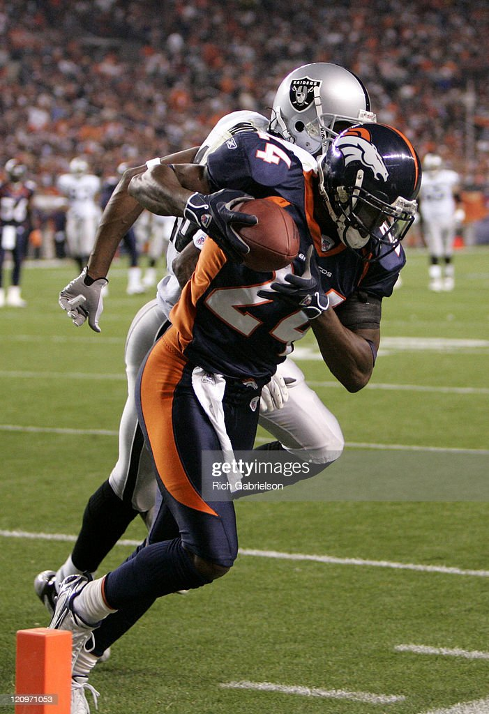 Cornerback <a gi-track='captionPersonalityLinkClicked' href=/galleries/search?phrase=Champ+Bailey&family=editorial&specificpeople=213482 ng-click='$event.stopPropagation()'>Champ Bailey</a> #24 intercepts a pass intended for Oakland Raiders wide receiver <a gi-track='captionPersonalityLinkClicked' href=/galleries/search?phrase=Randy+Moss&family=editorial&specificpeople=201999 ng-click='$event.stopPropagation()'>Randy Moss</a> #18. The Denver Broncos defeated the Oakland Raiders by a score of 13 to 3 at Invesco Field at Mile High, Denver, CO, October 15, 2006.