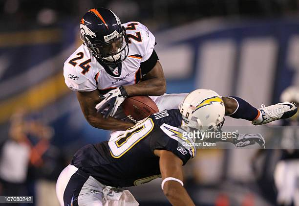 Cornerback Champ Bailey of the Denver Broncos intercepts a pass over wide receiver Malcom Floyd of the San Diego Chargers at Qualcomm Stadium on...