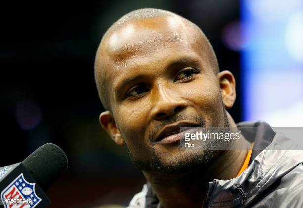 Cornerback Champ Bailey of the Denver Broncos speaks to the media during Super Bowl XLVIII Media Day at the Prudential Center on January 28 2014 in...