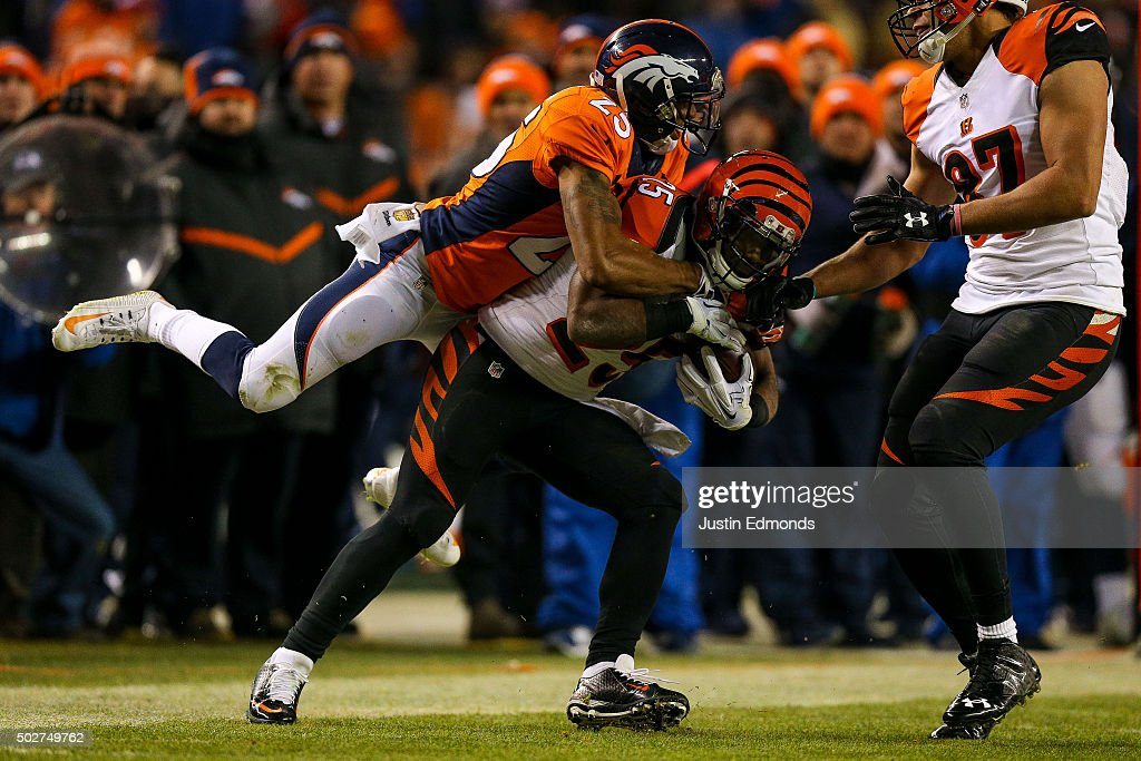 Cornerback <a gi-track='captionPersonalityLinkClicked' href=/galleries/search?phrase=Chris+Harris+-+American+Football+Cornerback&family=editorial&specificpeople=15029474 ng-click='$event.stopPropagation()'>Chris Harris</a> #25 of the Denver Broncos leaps on the back of running back <a gi-track='captionPersonalityLinkClicked' href=/galleries/search?phrase=Giovani+Bernard&family=editorial&specificpeople=8162745 ng-click='$event.stopPropagation()'>Giovani Bernard</a> #25 of the Cincinnati Bengals for a tackle during a game at Sports Authority Field at Mile High on December 28, 2015 in Denver, Colorado.