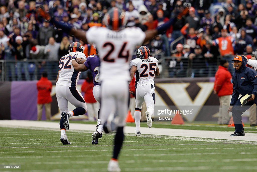 Cornerback Chris Harris #25 of the Denver Broncos returns an interception for a touchdown during the second quarter against the Baltimore Ravens at M&T Bank Stadium on December 16, 2012 in Baltimore, Maryland.