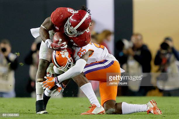 Cornerback Cordrea Tankersley of the Clemson Tigers tackles running back Bo Scarbrough of the Alabama Crimson Tide during the second half of the 2017...