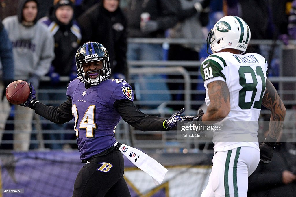 Cornerback <a gi-track='captionPersonalityLinkClicked' href=/galleries/search?phrase=Corey+Graham&family=editorial&specificpeople=4294650 ng-click='$event.stopPropagation()'>Corey Graham</a> #24 of the Baltimore Ravens celebrates in front of tight end Kellen Winslow #81 of the New York Jets after making an interception in the fourth quarter at M&T Bank Stadium on November 24, 2013 in Baltimore, Maryland. The Baltimore Ravens won, 19-3.