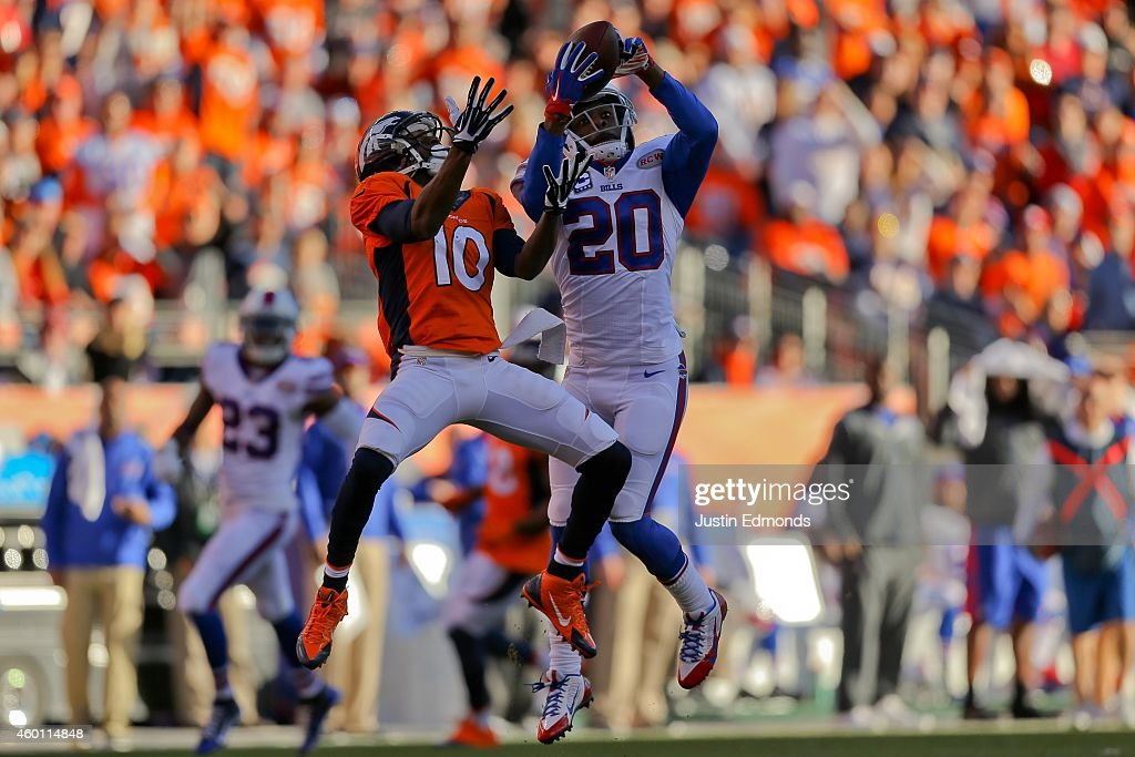 Cornerback <a gi-track='captionPersonalityLinkClicked' href=/galleries/search?phrase=Corey+Graham&family=editorial&specificpeople=4294650 ng-click='$event.stopPropagation()'>Corey Graham</a> #20 of the Buffalo Bills intercepts a pass intended for wide receiver <a gi-track='captionPersonalityLinkClicked' href=/galleries/search?phrase=Emmanuel+Sanders&family=editorial&specificpeople=5798683 ng-click='$event.stopPropagation()'>Emmanuel Sanders</a> #10 of the Denver Broncos during the second quarter at Sports Authority Field Field at Mile High on December 7, 2014 in Denver, Colorado.