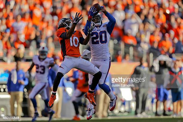 Cornerback Corey Graham of the Buffalo Bills intercepts a pass intended for wide receiver Emmanuel Sanders of the Denver Broncos during the second...