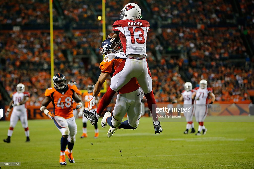 Cornerback Curtis Marsh #38 of the Denver Broncos is penalized for pass interference as he defends against Jaron Brown #13 of the Arizona Cardinals during preseason action at Sports Authority Field at Mile High on September 3, 2015 in Denver, Colorado.