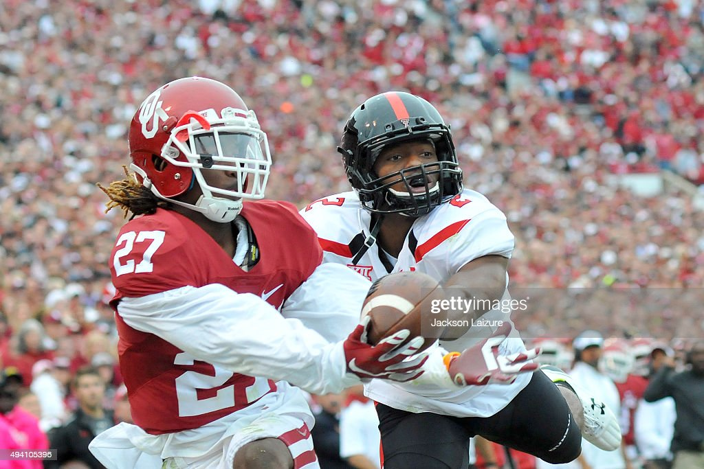 Cornerback Dakota Austin #27 of the Oklahoma Sooners intercepts a pass intended for wide receiver Reginald Davis #2 of the Texas Tech Red Raiders just before halftime during their game on October 24, 2015 at the Gaylord Family Oklahoma Memorial Stadium in Norman, Oklahoma.