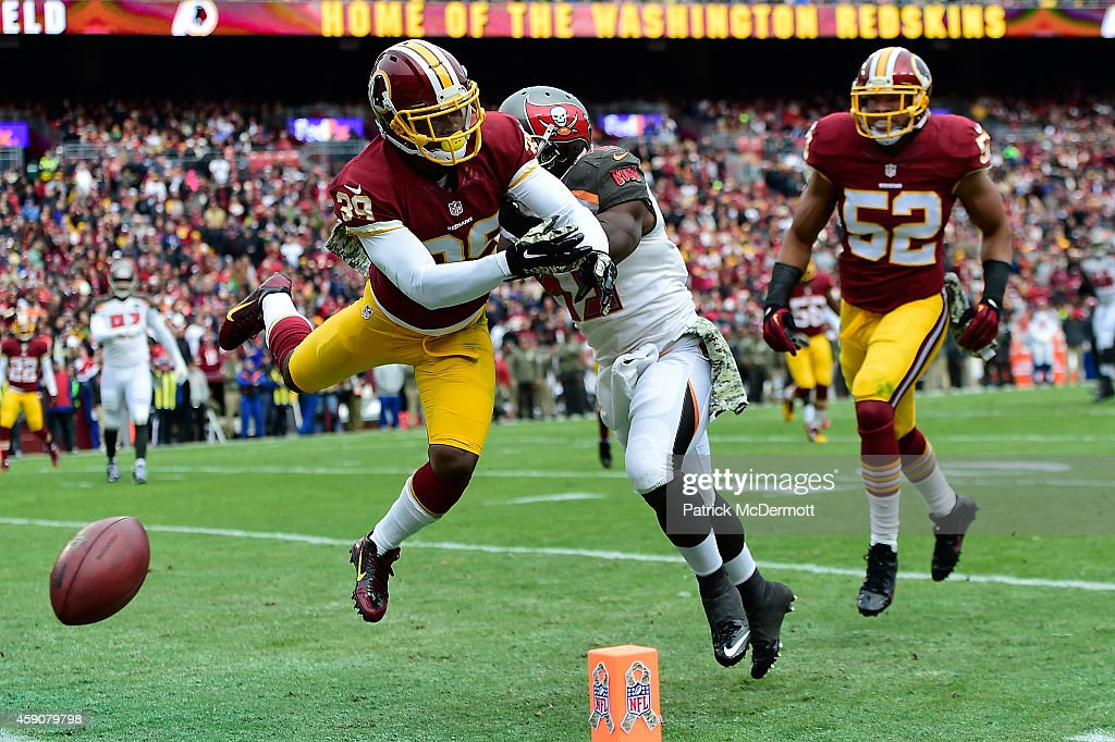 Cornerback <a gi-track='captionPersonalityLinkClicked' href=/galleries/search?phrase=David+Amerson&family=editorial&specificpeople=7244765 ng-click='$event.stopPropagation()'>David Amerson</a> #39 of the Washington Redskins breaks up a pass intended for running back <a gi-track='captionPersonalityLinkClicked' href=/galleries/search?phrase=Bobby+Rainey&family=editorial&specificpeople=5555205 ng-click='$event.stopPropagation()'>Bobby Rainey</a> #43 of the Tampa Bay Buccaneers at FedExField on November 16, 2014 in Landover, Maryland.