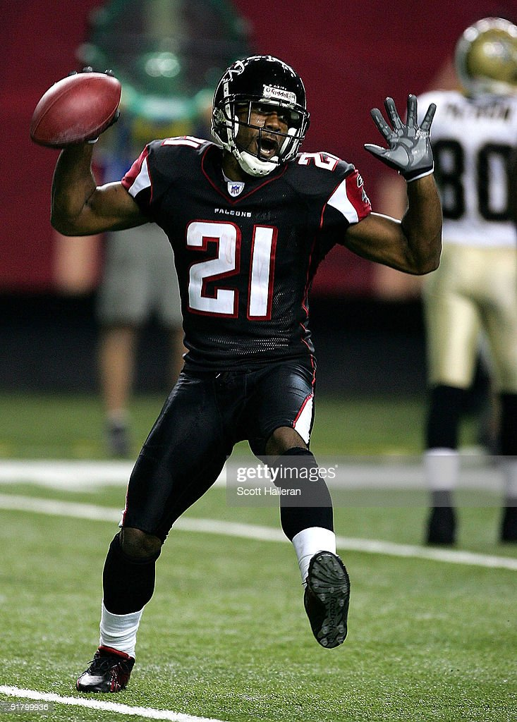 Cornerback DeAngelo Hall of the Atlanta Falcons celebrates his interception to end the game against the New Orleans Saints at the Georgia Dome on...