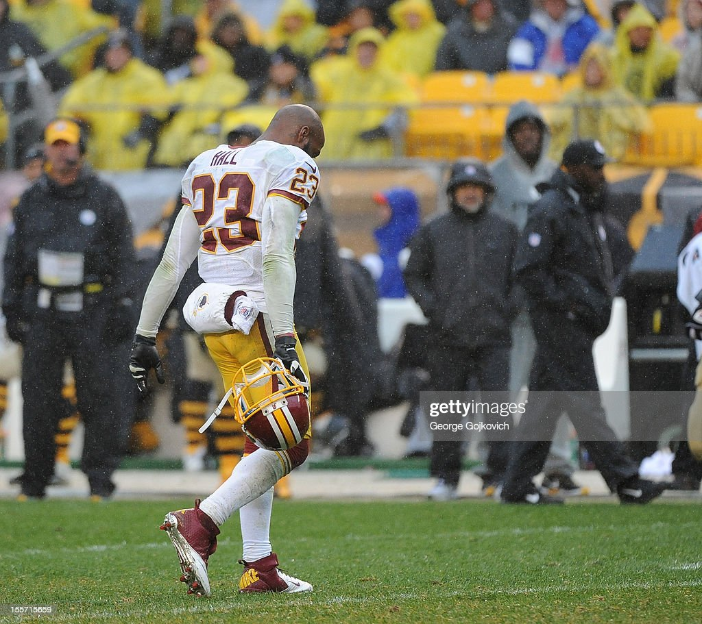 Cornerback DeAngelo Hall of the Washington Redskins leaves the field after he was ejected from the game following an unsportsmanlike conduct penalty...