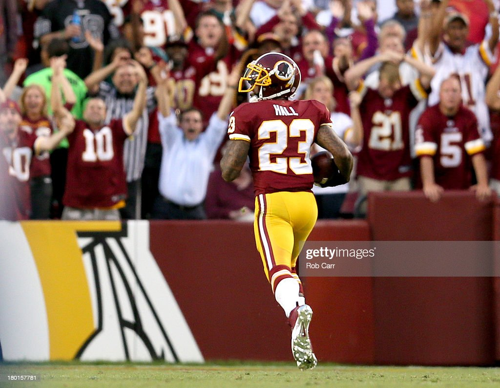 Cornerback DeAngelo Hall of the Washington Redskins returns a blocked backwards pass 75yards for a touchdown in the first quarter against the...