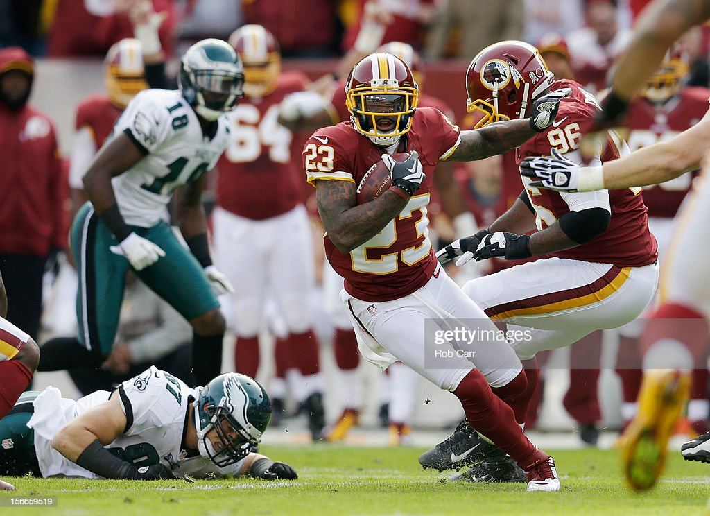 Cornerback DeAngelo Hall of the Washington Redskins rushes the ball after intercepting a Philadelphia Eagles pass during the first quarter at FedEx...