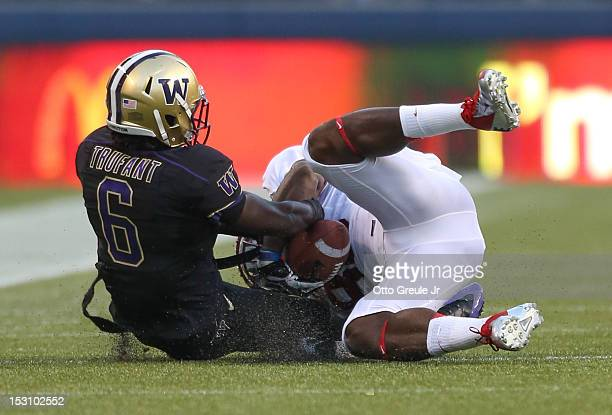 Cornerback Desmond Trufant of the Washington Huskies breaks up a pass to wide receiver Ty Montgomery of the Stanford Cardinal on September 27 2012 at...
