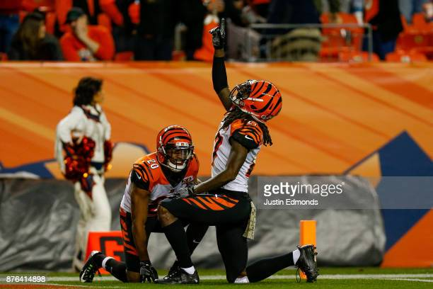 Cornerback Dre Kirkpatrick of the Cincinnati Bengals celebrates along with KeiVarae Russell after sealing the game with a turnover on downs against...