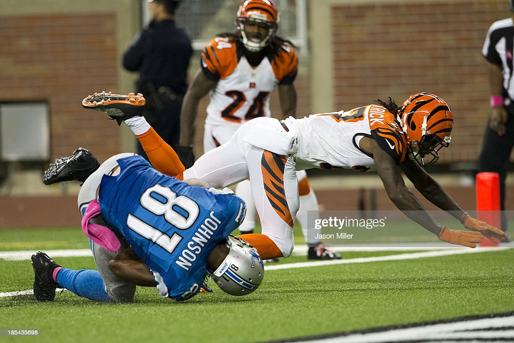 Cornerback <a gi-track='captionPersonalityLinkClicked' href=/galleries/search?phrase=Dre+Kirkpatrick&family=editorial&specificpeople=6699002 ng-click='$event.stopPropagation()'>Dre Kirkpatrick</a> #27 of the Cincinnati Bengals tackles wide receiver <a gi-track='captionPersonalityLinkClicked' href=/galleries/search?phrase=Calvin+Johnson+-+American+Football+Player&family=editorial&specificpeople=2253942 ng-click='$event.stopPropagation()'>Calvin Johnson</a> #81 of the Detroit Lions as Johnson lands in the end zone for a touchdown during the second half at Ford Field on October 20, 2013 in Detroit, Michigan. The Bengals defeated the Lions 27-24.