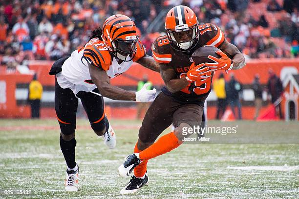 Cornerback Dre Kirkpatrick of the Cincinnati Bengals tackles wide receiver Corey Coleman of the Cleveland Browns during the second half at...