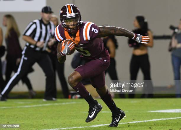Cornerback Greg Stroman of the Virginia Tech Hokies returns a kick against the Clemson Tigers in the first half at Lane Stadium on September 30 2017...