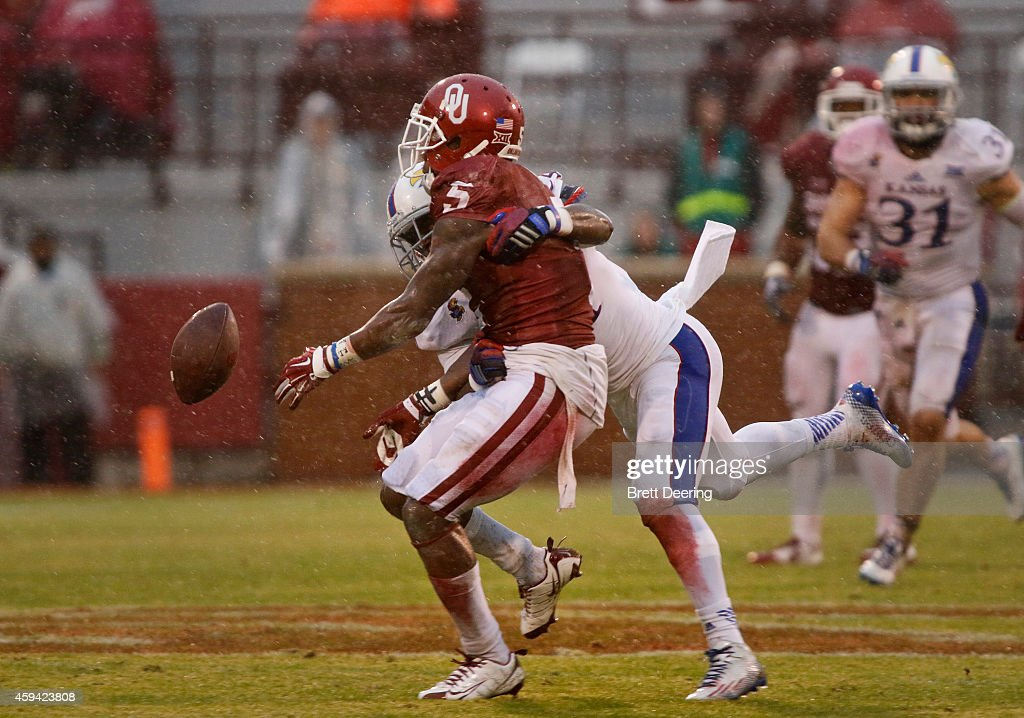 Cornerback JaCorey Shepherd #24 of the Kansas Jayhawks knocks loose a reception by wide receiver Durron Neal #5 of the Oklahoma Sooners November 22, 2014 at Gaylord Family-Oklahoma Memorial Stadium in Norman, Oklahoma. The Sooners defeated the Jayhawks 44-7.
