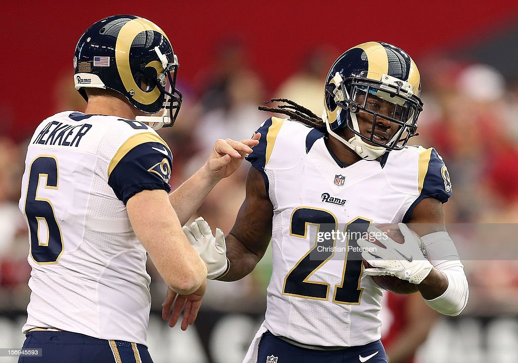 Cornerback Janoris Jenkins #21 of the St. Louis Rams celebrates with punter Johnny Hekker #6 after Jenkins scored a 36 yard touchdown interception against the Arizona Cardinals during the second quarter of the NFL game at the University of Phoenix Stadium on November 25, 2012 in Glendale, Arizona.