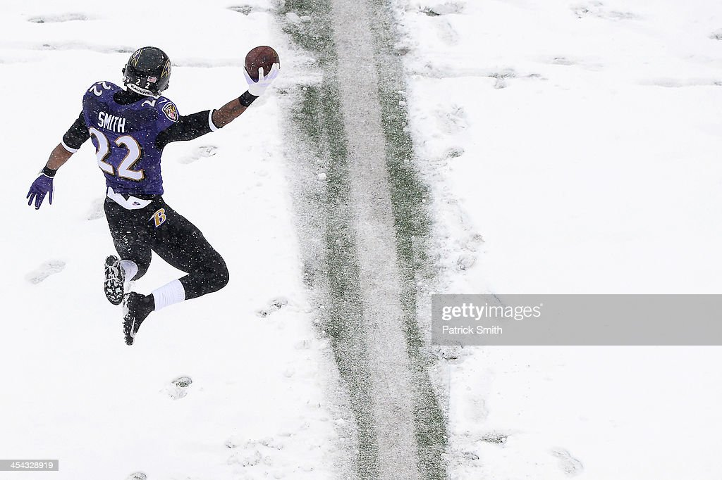 Cornerback Jimmy Smith #22 of the Baltimore Ravens celebrates after a play in the first half against the Minnesota Vikings at M&T Bank Stadium on December 8, 2013 in Baltimore, Maryland. The Baltimore Ravens won, 29-26.
