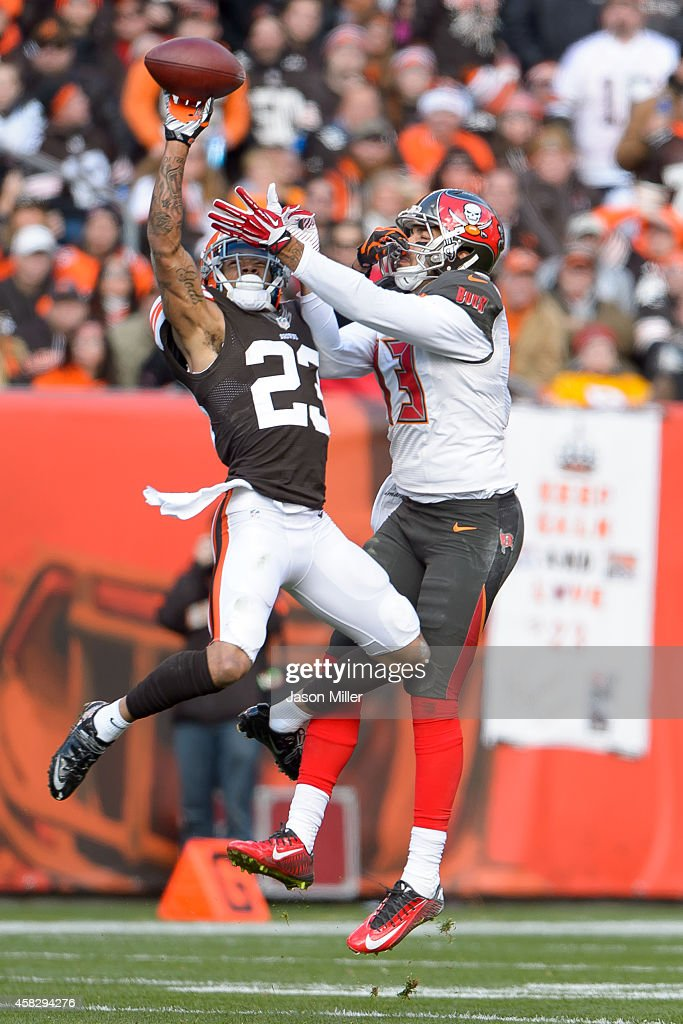 Cornerback <a gi-track='captionPersonalityLinkClicked' href=/galleries/search?phrase=Joe+Haden&family=editorial&specificpeople=4489430 ng-click='$event.stopPropagation()'>Joe Haden</a> #23 of the Cleveland Browns breaks up a pass intended for wide receiver <a gi-track='captionPersonalityLinkClicked' href=/galleries/search?phrase=Mike+Evans+-+American+Football+Wide+Receiver&family=editorial&specificpeople=12684996 ng-click='$event.stopPropagation()'>Mike Evans</a> #13 of the Tampa Bay Buccaneers during the first half at FirstEnergy Stadium on November 2, 2014 in Cleveland, Ohio.