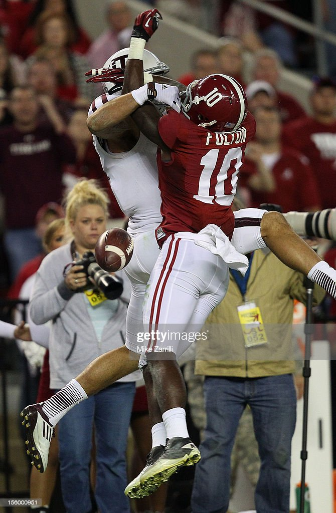 Cornerback John Fulton #10 of the Alabama Crimson Tide breaks up a pass to wide receiver Mike Evans #13 of the Texas A&M Aggies during the game at Bryant-Denny Stadium on November 10, 2012 in Tuscaloosa, Alabama.