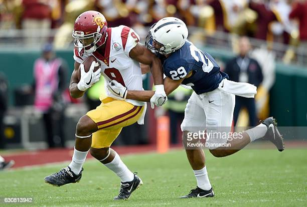 Cornerback John Reid of the Penn State Nittany Lions attempts to tackle wide receiver JuJu SmithSchuster of the USC Trojans in the first half of the...