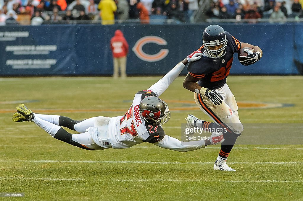 Cornerback <a gi-track='captionPersonalityLinkClicked' href=/galleries/search?phrase=Johnthan+Banks&family=editorial&specificpeople=6393014 ng-click='$event.stopPropagation()'>Johnthan Banks</a> #27 of the Tampa Bay Buccaneers hangs onto running back <a gi-track='captionPersonalityLinkClicked' href=/galleries/search?phrase=Matt+Forte&family=editorial&specificpeople=2246847 ng-click='$event.stopPropagation()'>Matt Forte</a> #22 of the Chicago Bears in the third quarter at Soldier Field on November 23, 2014 in Chicago, Illinois.