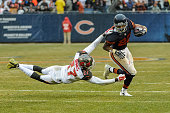 Cornerback Johnthan Banks of the Tampa Bay Buccaneers hangs onto running back Matt Forte of the Chicago Bears in the third quarter at Soldier Field...