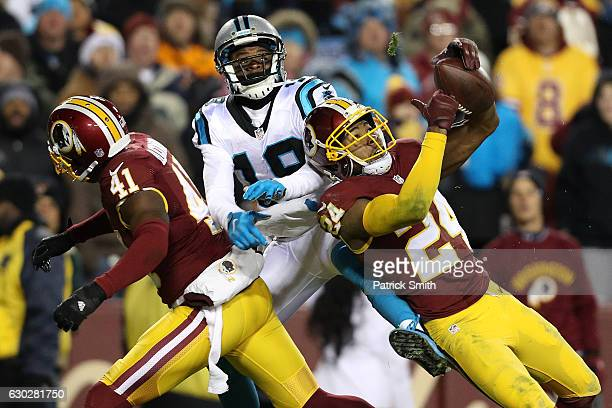 Cornerback Josh Norman of the Washington Redskins breaks up a pass intended for wide receiver Ted Ginn of the Carolina Panthers in the third quarter...
