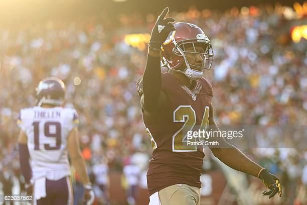 Cornerback Josh Norman of the Washington Redskins reacts after teammate outside linebacker Preston Smith sacked quarterback Sam Bradford of the...