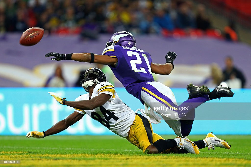 Cornerback Josh Robinson #21 of the Minnesota Vikings and wide receiver Antonio Brown #84 of the Pittsburgh Steelers stretch for the ball during the NFL International Series game between Pittsburgh Steelers and Minnesota Vikings at Wembley Stadium on September 29, 2013 in London, England.