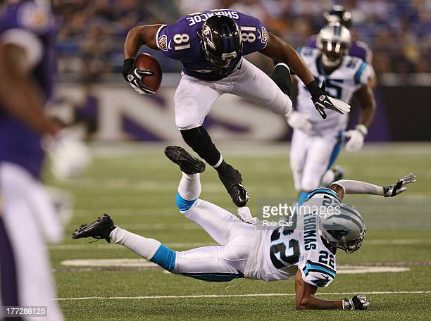 Cornerback Josh Thomas of the Carolina Panthers trips up Visanthe Shiancoe of the Baltimore Ravens during the second half of a preseason game at MT...