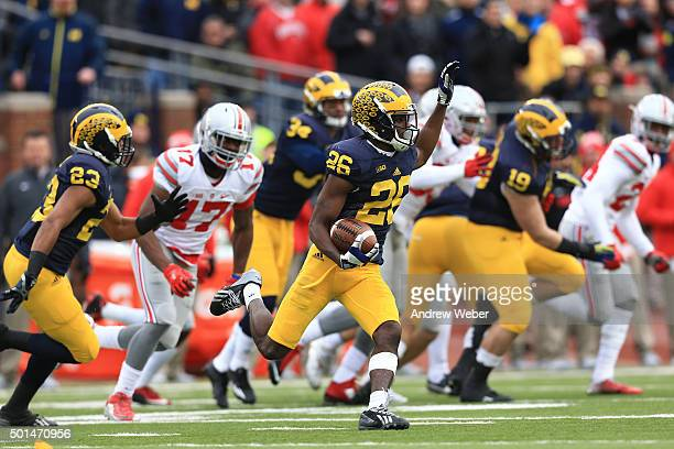 Cornerback Jourdan Lewis of the Michigan Wolverines runs the ball during the game against the Ohio State Buckeyes at Michigan Stadium on November 28...