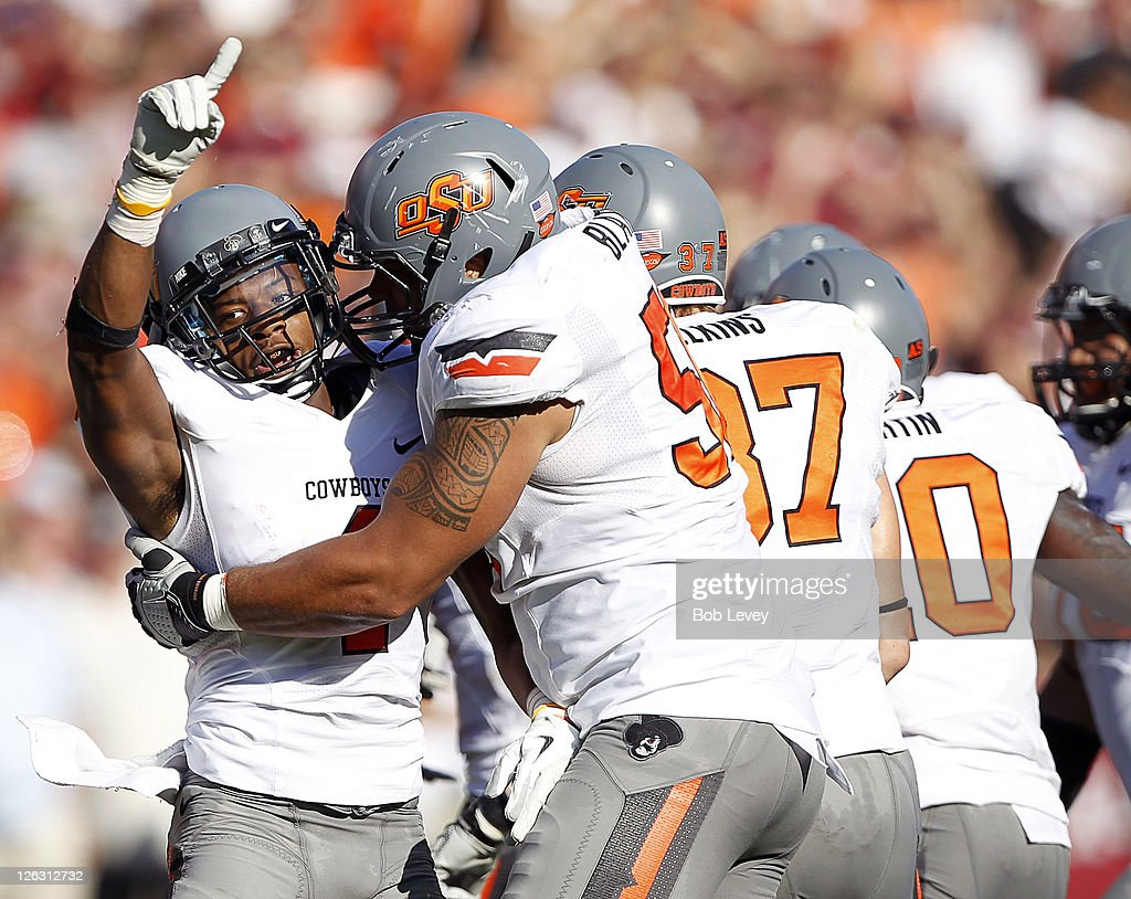 Cornerback Justin Gilbert #4 of the Oklahoma State Cowboys celebrates with Jamie Blatnick #50 after recovering a Texas A&M Aggies fumble at Kyle Field on September 24, 2011 in College Station, Texas.