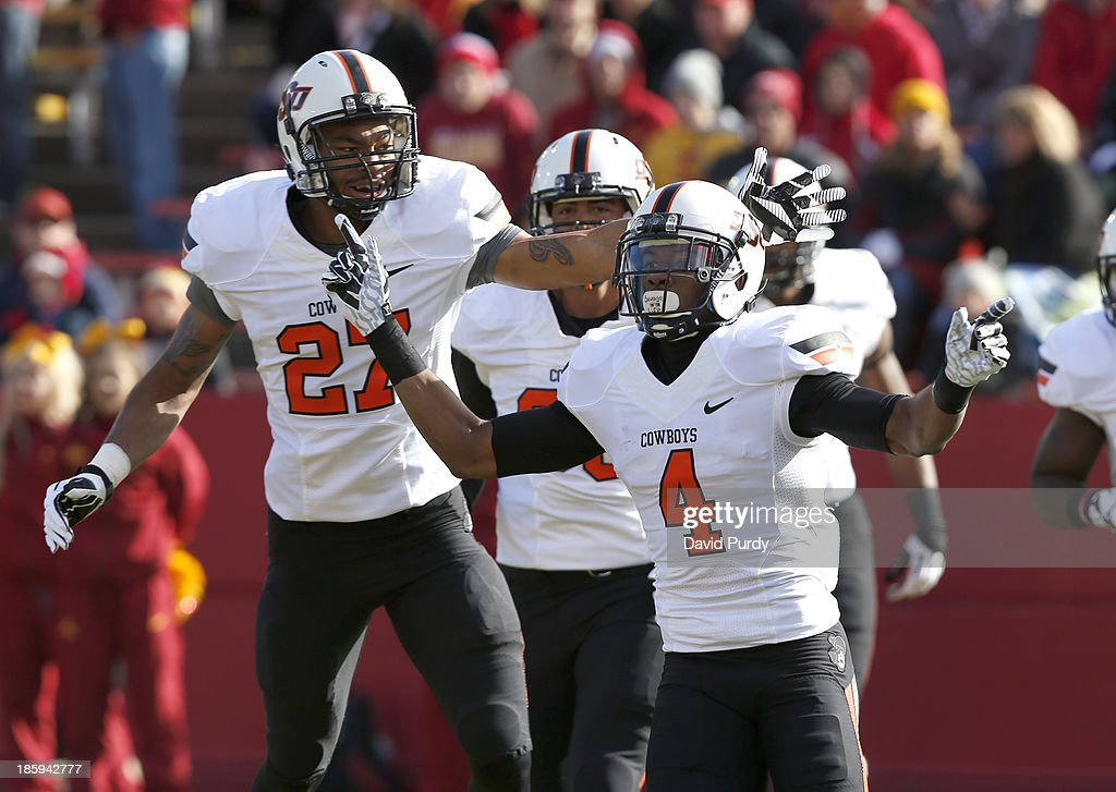 Cornerback Justin Gilbert #4 of the Oklahoma State Cowboys celebrates with teammate safety Lyndell Johnson #27 after he returned a intercepted pass for a touchdown in the first half of play at Jack Trice Stadium on October 26, 2013 in Ames, Iowa.